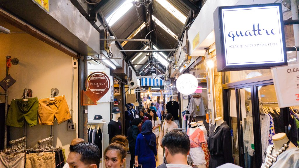 Boutique shops in the small aisles at JJ Market