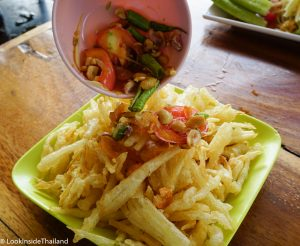 Thai food som tam poo papaya salad deep fried with spicy toppings